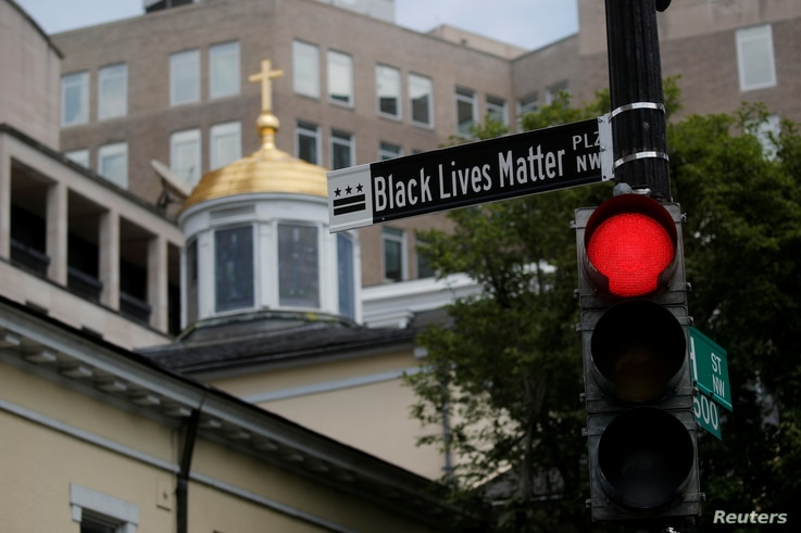 "A sign reading ""Black lives Matter"" is seen on a light pole 16th Street near of the White House as the protests against the…"