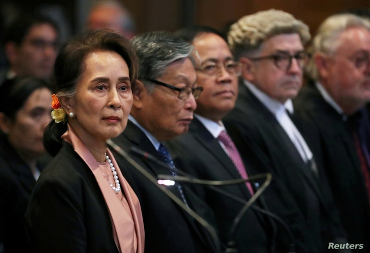 FILE PHOTO: Myanmar's leader Aung San Suu Kyi attends a hearing in a case filed by Gambia against Myanmar alleging genocide…