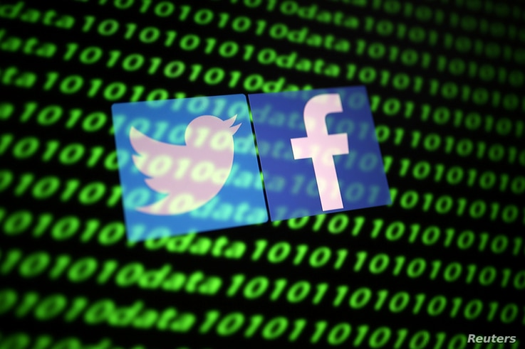 FILE PHOTO: The Twitter and Facebook logo along with binary cyber codes are seen in this illustration taken November 26, 2019…