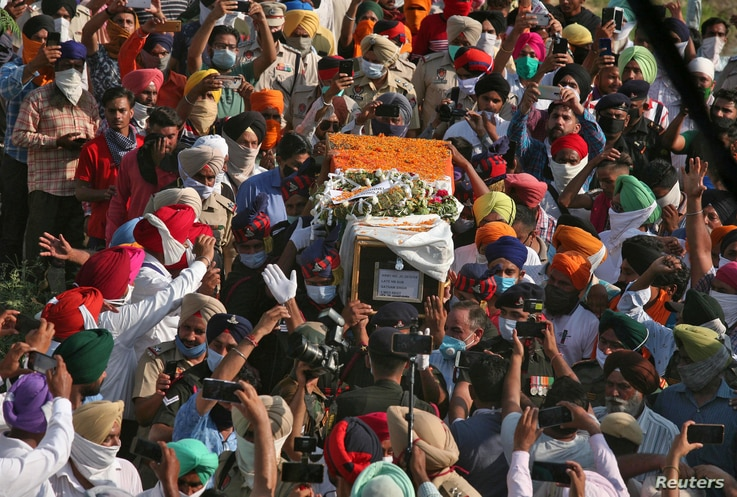 People carry the coffin of Satnam Singh, an Indian soldier who was killed in a border clash with Chinese troops in Ladakh…