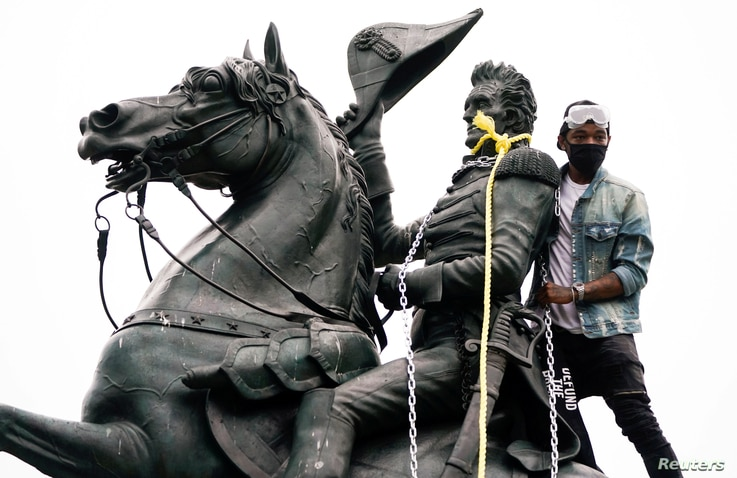 A protestor wraps chains and ropes around the statue of U.S. President Andrew Jackson in Washington.