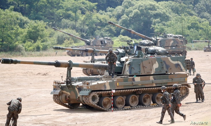South Korean soldiers take part in a live fire exercise near the demilitarized zone separating the two Koreas in Paju, South…