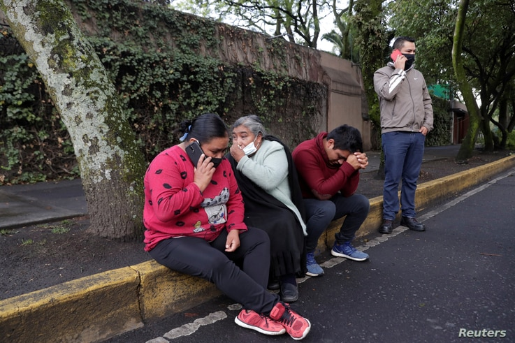 People react near the area where a shooting took place in Mexico City, Mexico, June 26, 2020. REUTERS/Henry Romero