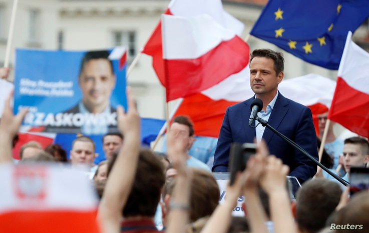 Warsaw mayor Rafal Trzaskowski, presidential candidate of the main opposition centre-right Civic Platform (PO) party, pauses…
