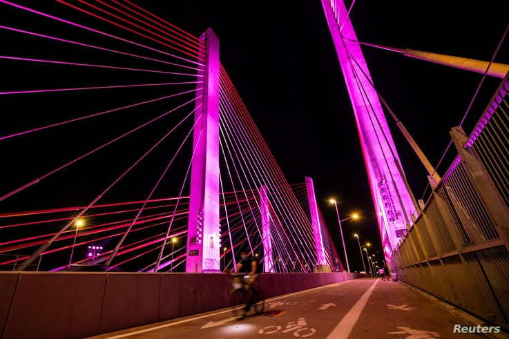 The Kosciuszko Bridge is lit in rainbow colors in support of the LGBT+ community, prior to the 51st anniversary of the Stonewall…