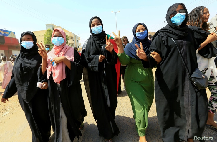 Civilians chant slogans as members of Sudanese pro-democracy protest on the anniversary of a major anti-military protest, as…