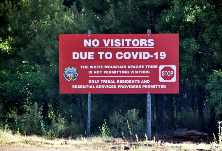 In this Thursday, June 25, 2020 photo provided by C.M. Clay, a sign alerts motorists that visitors are not allowed on the Fort…