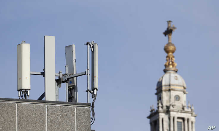 Mobile network phone masts are visible in front of St Paul's Cathedral in the City of London, Tuesday, Jan. 28, 2020.The…
