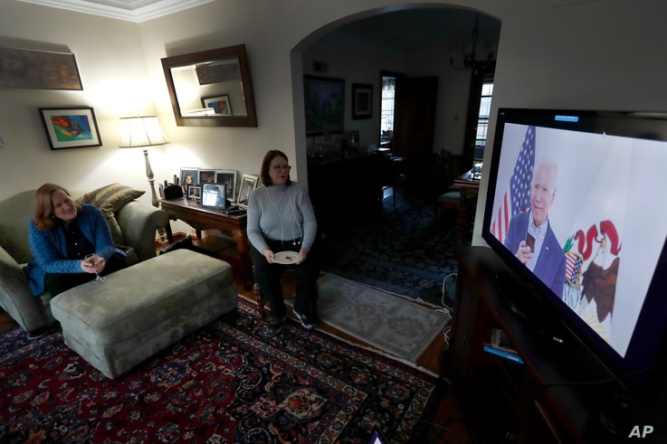 Lally Doerrer, right, and Katharine Hildebrand watch Joe Biden during his Illinois virtual town hall.