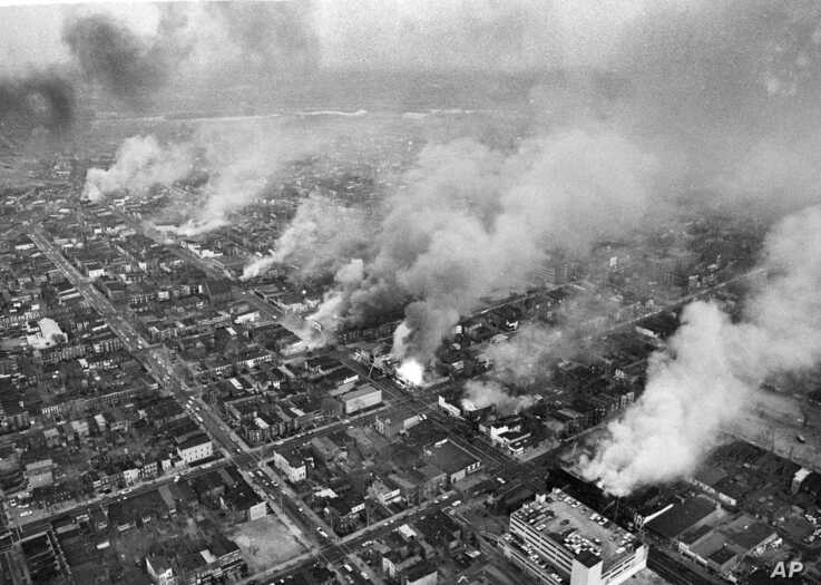 FILE - In this April 5, 1968 file photo, buildings burn in the northeast section of Washington, set afire during a day of demonstrations and rioting in reaction to the assassination of Dr. Martin Luther King Jr.
