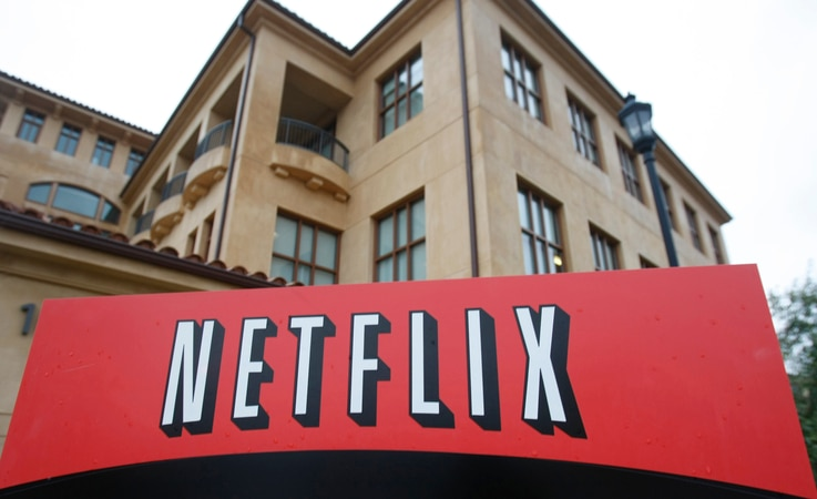 FILE - Company logo and view of Netflix headquarters in Los Gatos, Calif.