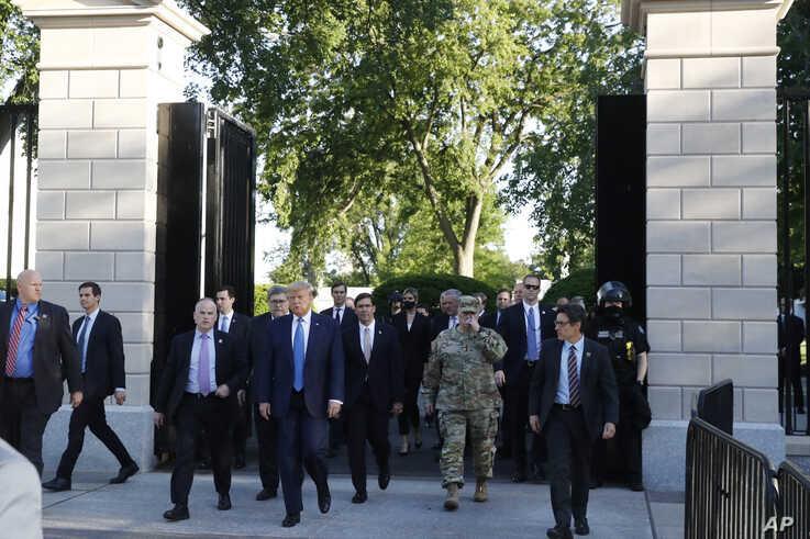 President Donald Trump walks from the gates of the White House to visit St. John's Church across Lafayette Park Monday, June 1,…