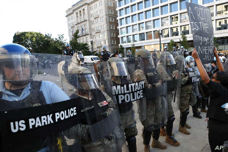 Police clear the area around Lafayette Park and the White House as demonstrators gather to protest the death of George Floyd,…