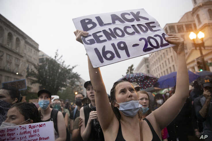 Demonstrators protest Friday, June 5, 2020, near the White House in Washington, over the death of George Floyd, a black man who was in police custody in Minneapolis. Floyd died after being restrained by Minneapolis police officers.