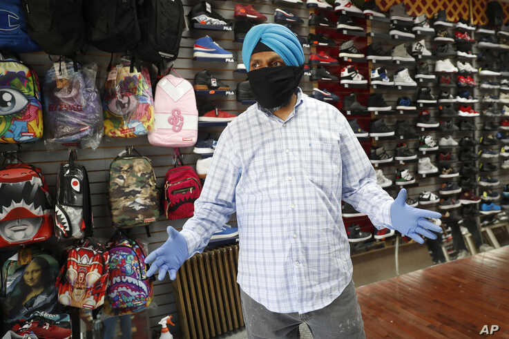 Multani Singh, owner of J&M sneakers, talks about keeping his business alive during nearly three months of shutdown, Monday,…