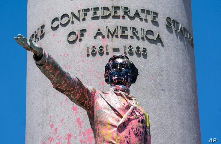 Paint and protest graffiti covers the Jefferson Davis Memorial in Richmond, Va., June 7, 2020, following a week of unrest in the U.S. against police brutality and racism in policing.