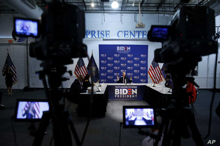 Democratic presidential candidate, former Vice President Joe Biden speaks during a roundtable on economic reopening with…