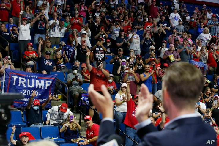 President Donald Trump supporters cheer Eric Trump, the son of President Donald Trump, before a Trump campaign rally in Tulsa,…