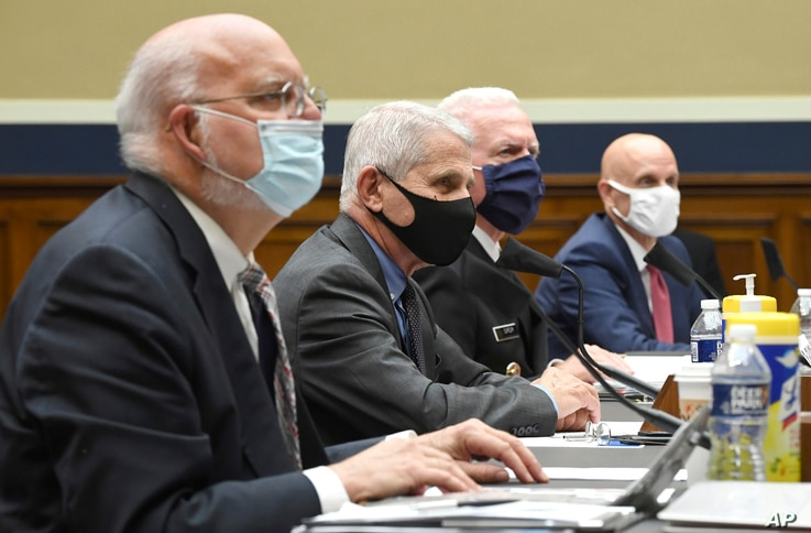From left to right, Dr. Robert Redfield, Director, Centers for Disease Control and Prevention; Dr. Anthony Fauci, Director,…