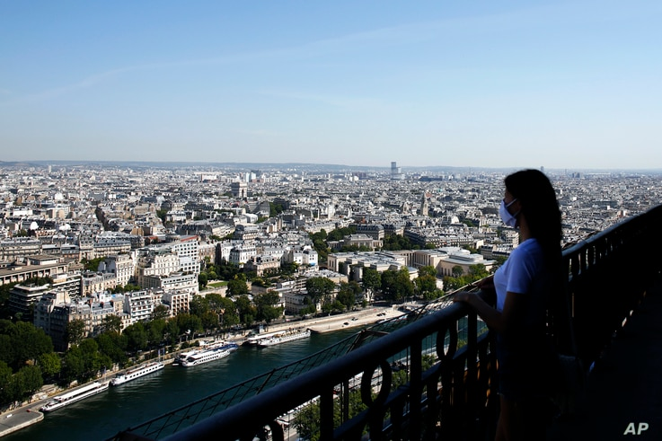 A visitor looks at the view from the Eiffel Tower, in Paris, June 25, 2020.