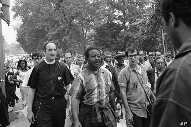 Civil rights leader Rev. Ralph Abernathy, center, is shown as he leads the Poor People's March toward the Capitol in Washington, June 24, 1968.
