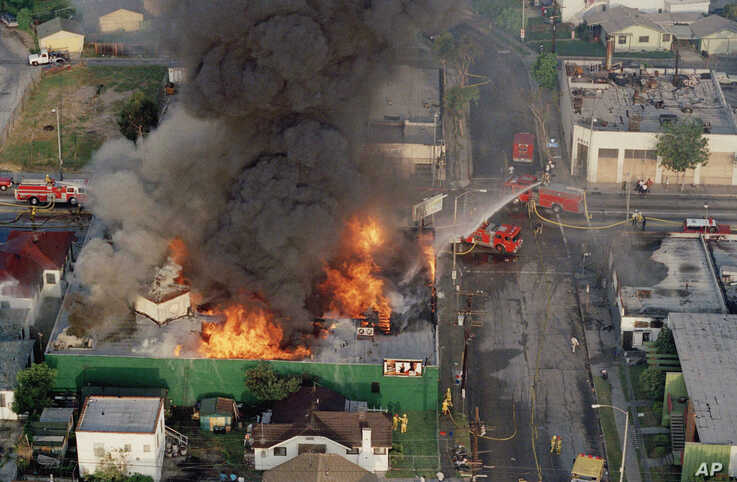 A fire burns out of control at the corner of 67th St. and West Blvd. in South Central Los Angeles April 30, 1992.