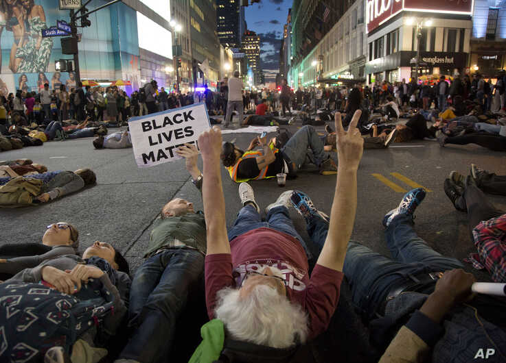 Protestors lay in the street to stage a die-in at Herald Square, Wednesday, April 29, 2015, in New York.