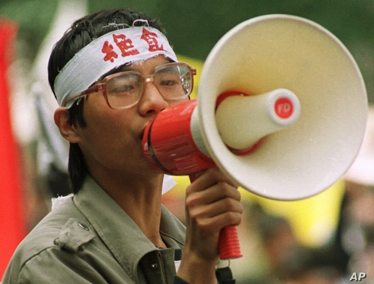 Chinese dissident Wang Dan addresses fellow students during a demonstration in Beijing's Tiananmen Square, in this May 1989 …