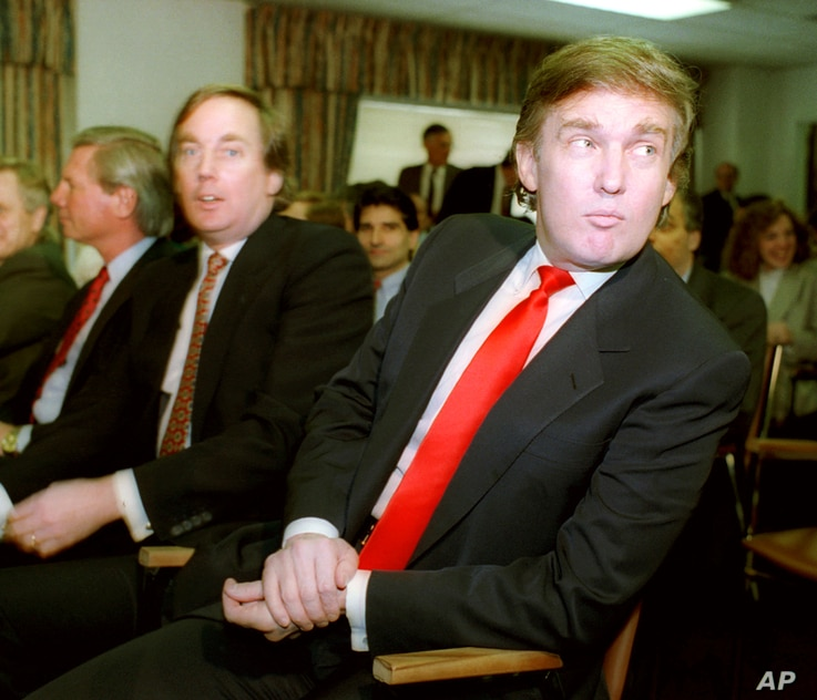 Billionaire developer Donald Trump, right, waits with his brother Robert for the start of a Casino Control Commission meeting…