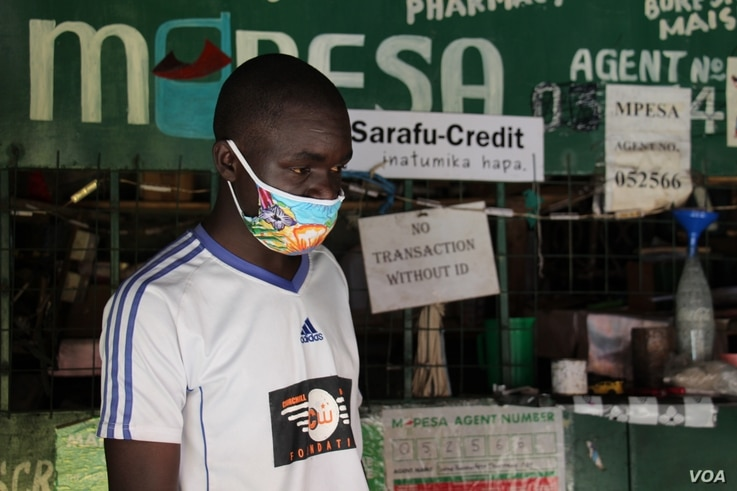 Peter Odhiambo, shop owner, his store is one of 100 food stores that accept Sarafu, a community initiative currency developed by Grassroots Economics and US based engineering firm BlockScience.