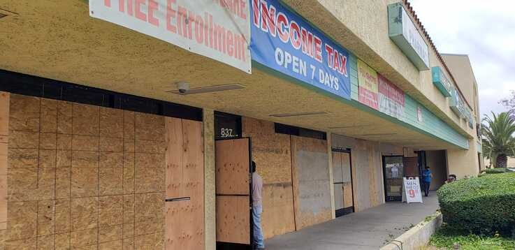 Businesses in the Cambodia Town section of Long Beach, Calif., are boarded up after recent looting.