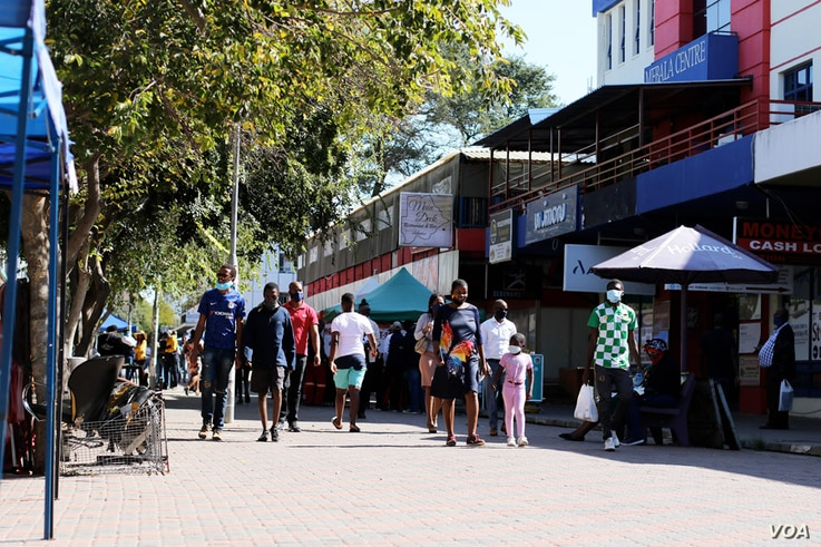 People going about their activities in Gaborone, Botswana, before authorities announced the city's return to lockdown on June 12