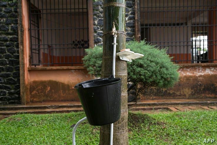 A tap with a bucket and a bar of soap is available for students to wash their hands as a preventive measure against the spread of the COVID-19 coronavirus at the Lycée Général Leclerc School in Yaoundé, Cameroon, June 1, 2020.