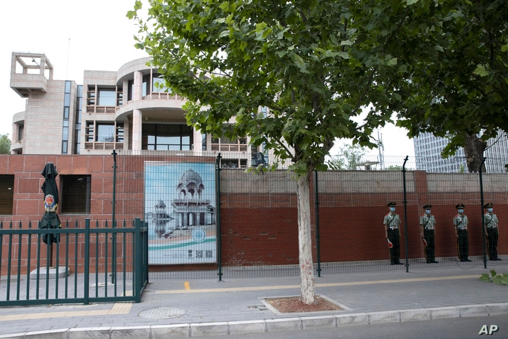 Chinese paramilitary policemen stand guard outside the Indian embassy in Beijing, June 17, 2020.