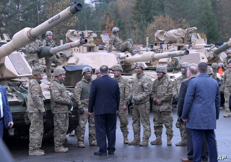 FILE - U.S. Secretary of State Mike Pompeo talks to U.S. soldiers based in Grafenwoehr, Germany, Nov. 7, 2019.