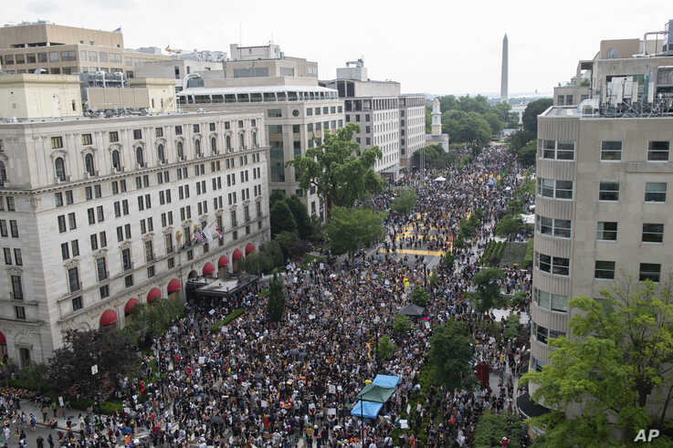 The Washington Monument and the White House are visible as protesters gather in Washington,June 6, 2020, over the death of George Floyd.