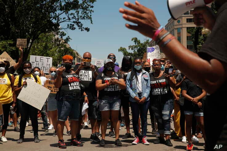 Demonstrators protest near the White House in Washington, June 7, 2020, over the death of George Floyd, an African American man who died after being restrained by Minneapolis police officers.