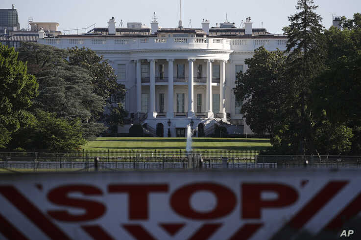 The White House is seen behind a vehicle barrier, in Washington, June 7, 2020, the morning after massive protests over the death of George Floyd were held in the U.S. capital.