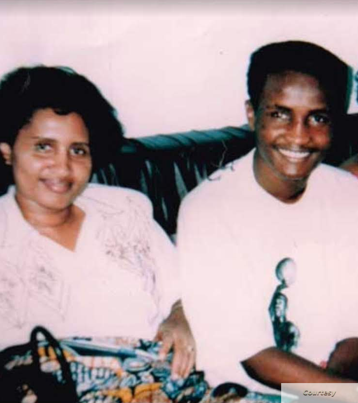 Caption for DIALLO-MOM & SON COUCH: Kadiatou and Amadou Diallo, from left, appear with a third person in an undated photo. (Courtesy Amadou Diallo Foundation)