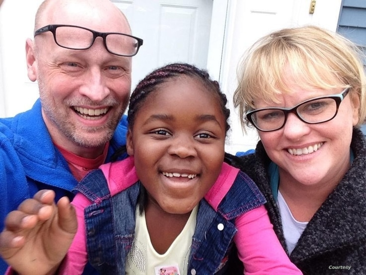 Steve and Melissa Pederson smile for a photo with their adoptive daughter Monique. (Courtesy - Steve Pederson)