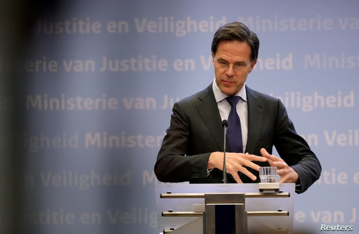 FILE - Dutch Prime Minister Mark Rutte speaks during his news conference in the Hague, Netherlands, March 19, 2020.
