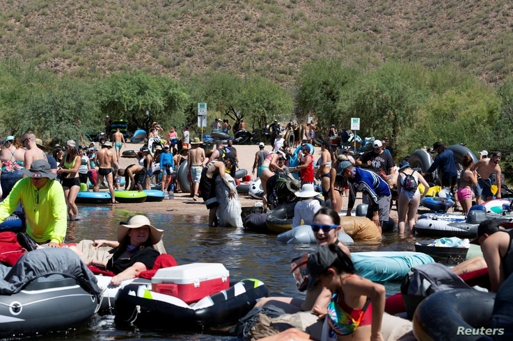 People prepare to go tubing on Salt River amid the outbreak of the coronavirus disease (COVID-19) in Arizona, June 27, 2020.