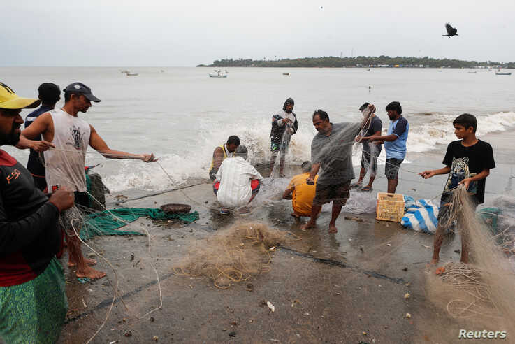 Fishermen gather their nets by the sea shore to store them before cyclone Nisarga makes its landfall, in Mumbai, India, June 3, 2020.