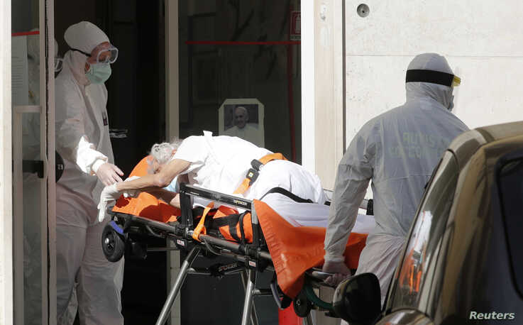 A patient is carried on a stretcher from a nursing home to a hospital, as the spread of the coronavirus disease (COVID-19) continues, in Rome, Italy, May 2, 2020.