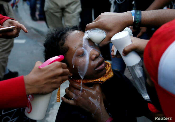 A woman affected by pepper spray is attended to by others during a protest at Lafayette Park near the White House in Washington, May 31, 2020, following the death of George Floyd in Minneapolis police custody.