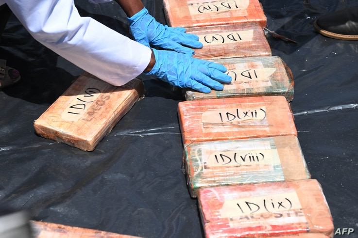 Kenyan officials display narcotics seized by anti-narcotics detectives in Mombasa in 2016, prior to the destruction at the…