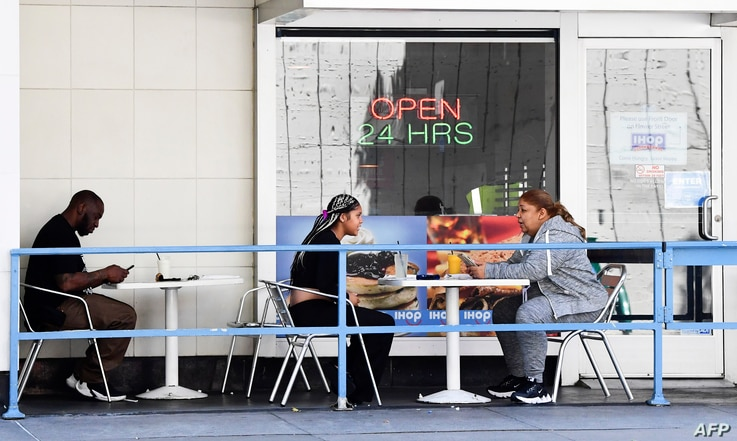 Patrons dine outdoor in Los Angeles, California, July 2, 2020, a day after new regulations came into effect…