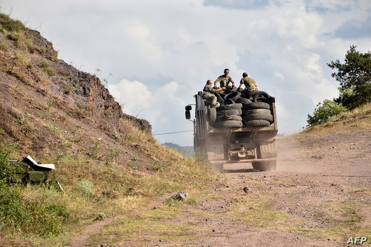 Armenian servicemen transport used tyres in the back of a truck to fortify their positions on the Armenian-Azerbaijani border…