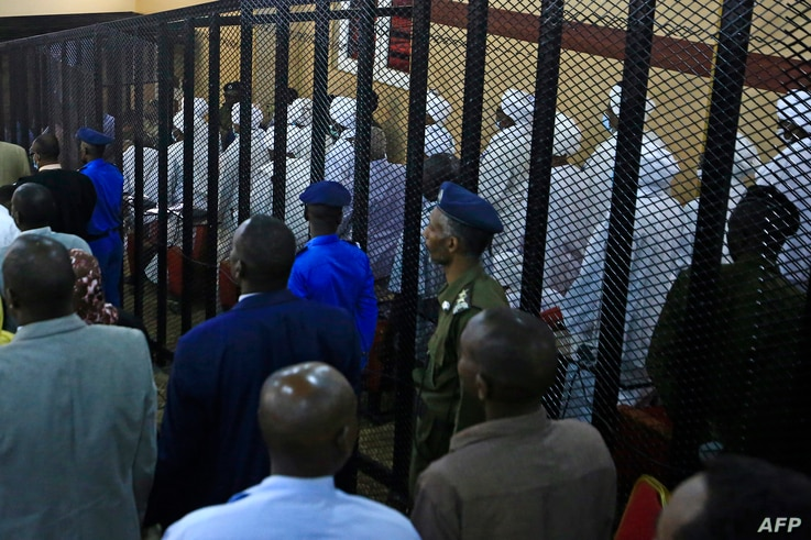 A partial view shows the trial of Sudan's ousted president Omar al-Bashir along with 27 co-accused at the Khartoum courthouse…
