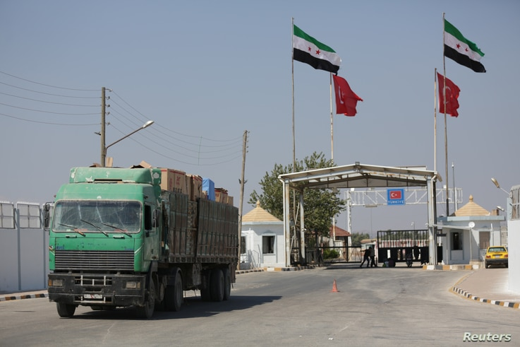 A Syrian truck carrying Turkish goods enters from Bab al Salam point near the city of Azaz, Syria August 20, 2018. Picture…